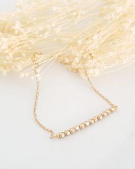 Bracelet perles dorées
